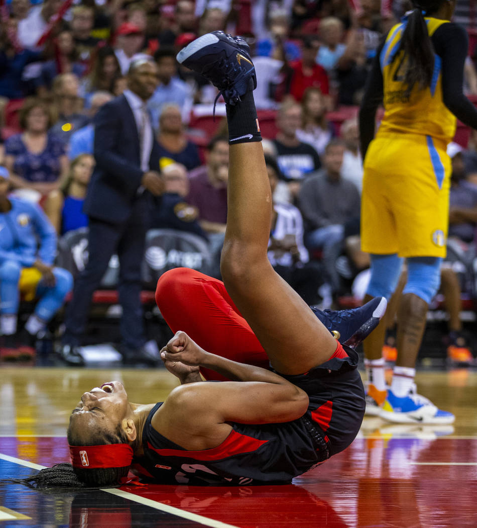 Las Vegas Aces center A'ja Wilson (22) rolls on the ground in celebration after a big shot over ...
