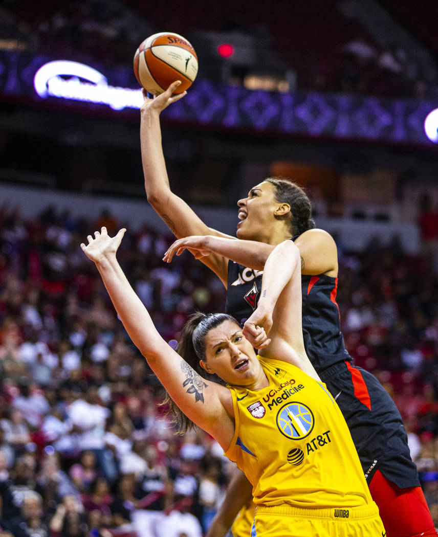 Las Vegas Aces center Liz Cambage (8, above) looks to get off a shot over the defense of Chicag ...