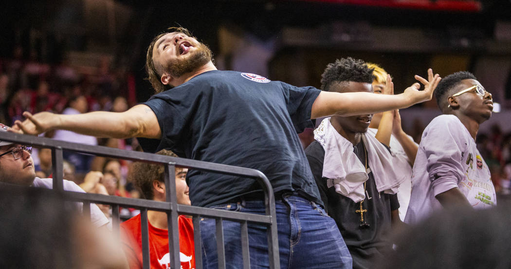 A Las Vegas Aces fan imitates the reaction of a Chicago Sky player in the second half of their ...