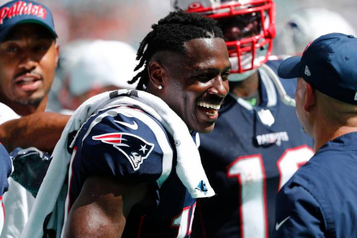 New England Patriots wide receiver Antonio Brown (17) smiles on the sidelines, during the secon ...