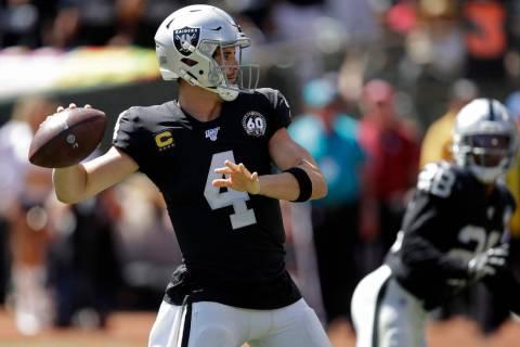 Oakland Raiders quarterback Derek Carr throws the ball during the first half of an NFL football ...