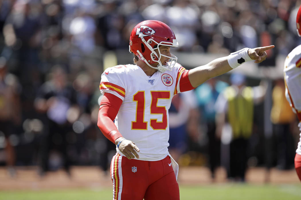 Kansas City Chiefs quarterback Patrick Mahomes calls a play during the first half of an NFL foo ...