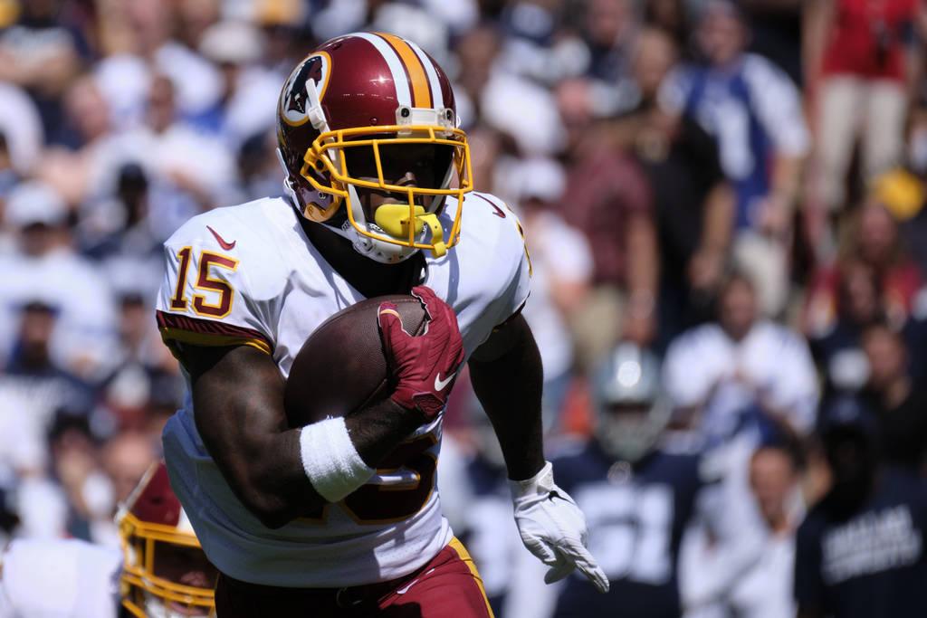 Washington Redskins wide receiver Steven Sims (15) runs the ball during an NFL football game ag ...