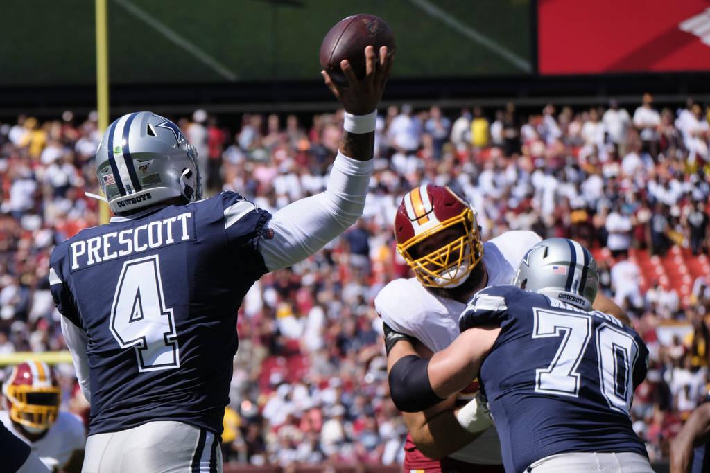 Dallas Cowboys quarterback Dak Prescott (4) throws during an NFL football game against the Wash ...