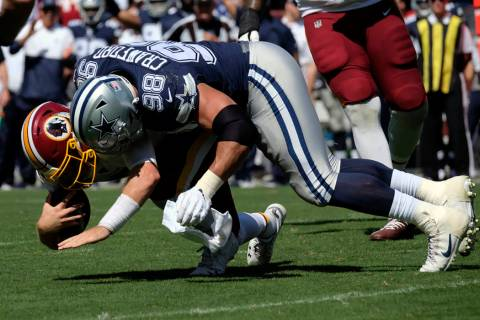 Dallas Cowboys defensive tackle Tyrone Crawford (98) sacks Washington Redskins quarterback Case ...