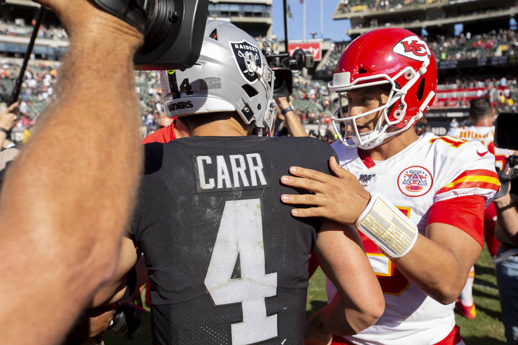 Kansas City Chiefs quarterback Patrick Mahomes, right, greets Oakland Raiders quarterback Derek ...