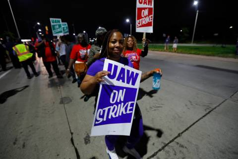 United Auto Workers members picket outside the General Motors Detroit-Hamtramck assembly plant ...