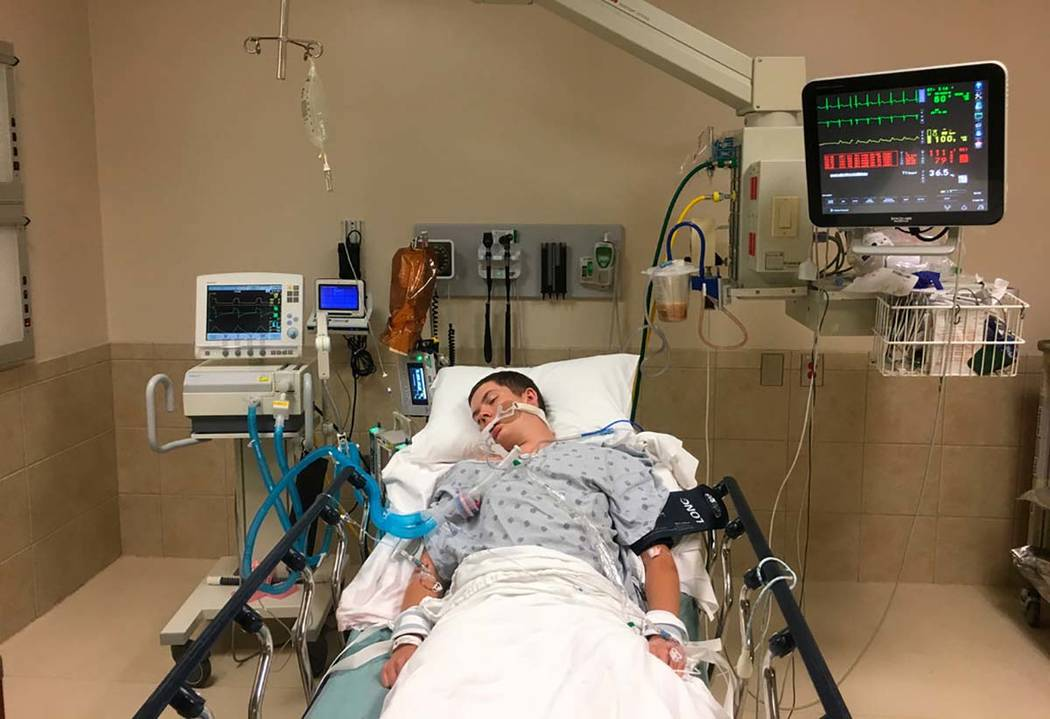 This May 2018, photo provided by Joseph Jenkins shows his son, Jay, in the emergency room of th ...