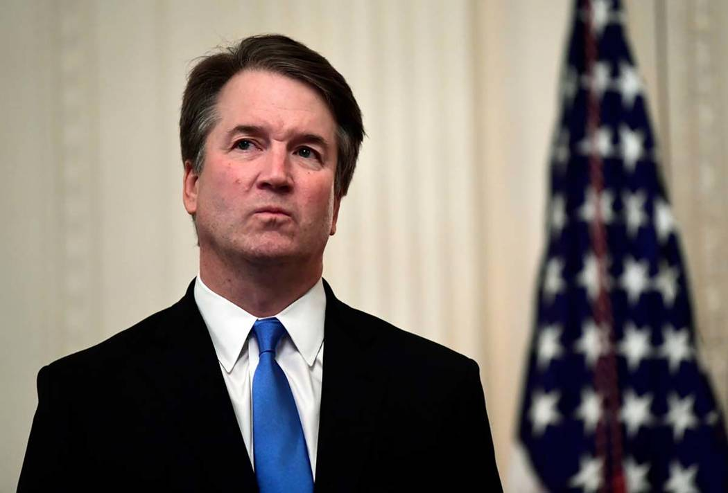 In this Oct. 8, 2018, file photo, Supreme Court Justice Brett Kavanaugh stands before a ceremon ...