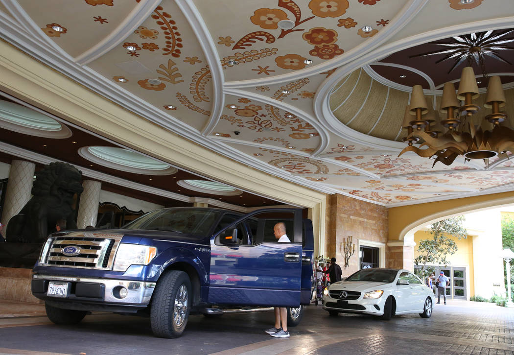 Valet drivers prepare to park gusts' cars at Wynn Las Vegas valet parking drop-off area on Mond ...