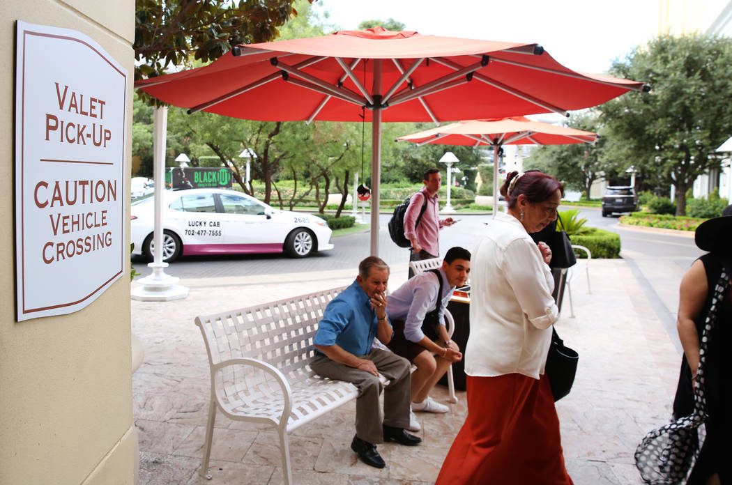 Hotel guests at Wynn Las Vegas wait for their cars at valet parking pick-up area on Monday, Sep ...