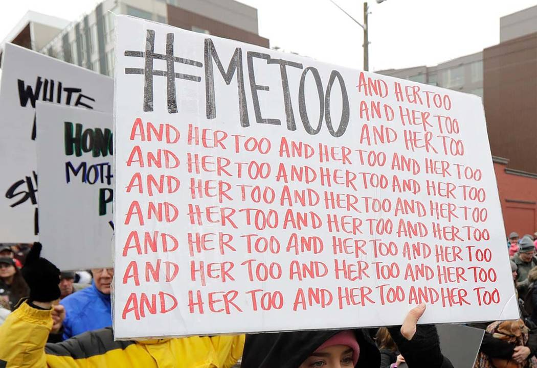 In this Jan. 20, 2018 file photo, a marcher carries a sign with the popular Twitter hashtag #Me ...