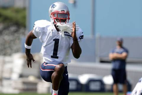 New England Patriots wide receiver Antonio Brown works out during NFL football practice, Wednes ...