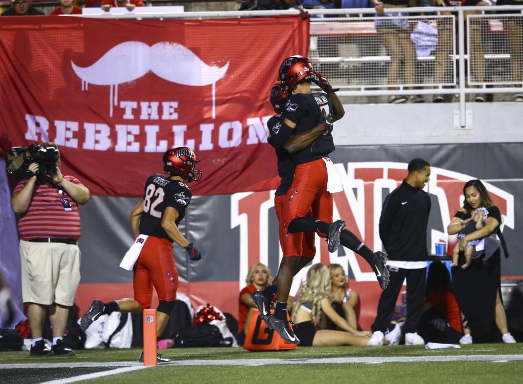 UNLV Rebels wide receiver Randal Grimes celebrates his touchdown with quarterback Kenyon Oblad ...