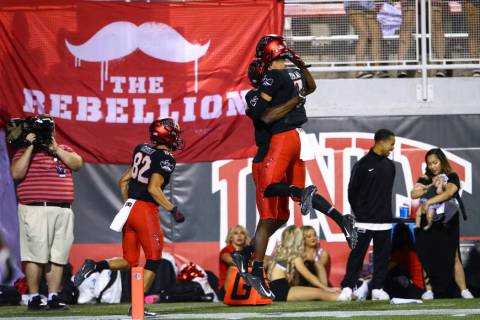 UNLV Rebels wide receiver Randal Grimes celebrates his touchdown with quarterback Kenyon Oblad ...