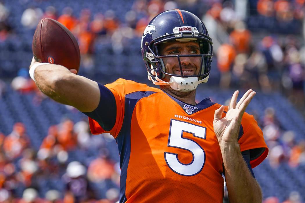 Denver Broncos quarterback Joe Flacco throws before an NFL football game between the Denver Bro ...