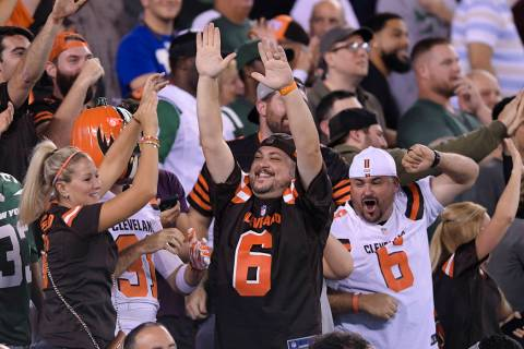 Cleveland Browns fans cheer during the second half of an NFL football game against the New York ...
