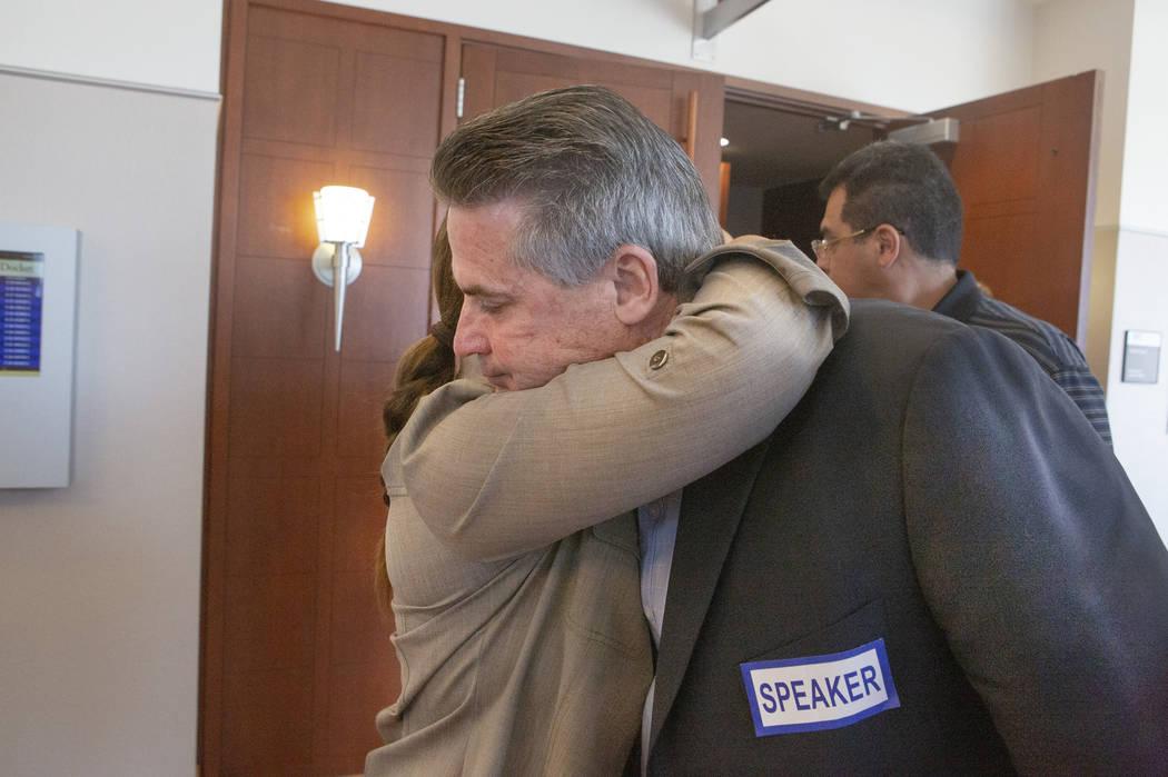 Retired Metro sergeant Steven Meriwether, hugs Kelly Brewer, the mother of Alexander Brewer, af ...