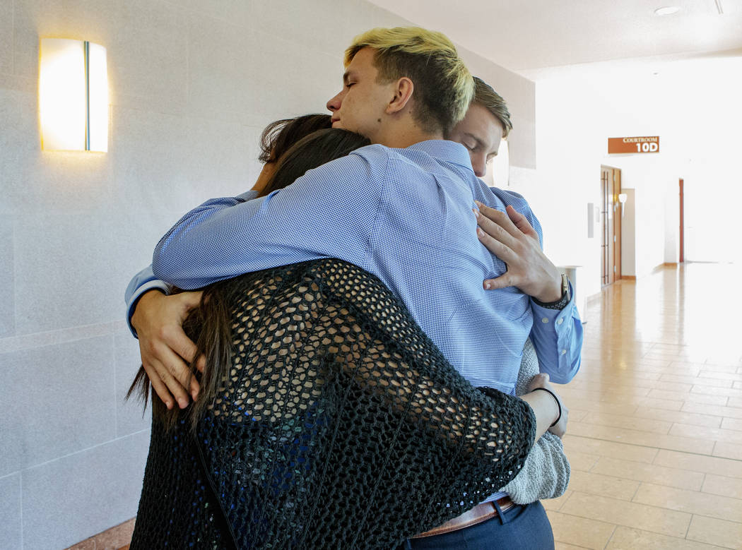 Friends of Garrett Meriwether embrace after the sentence in which Alexander Brewer pleaded guil ...