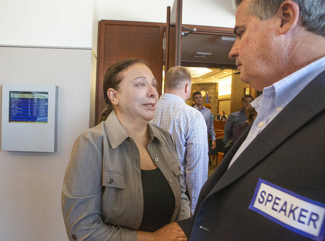 Retired Metro sergeant Steven Meriwether, talks to Kelly Brewer, as she cries after the sentenc ...