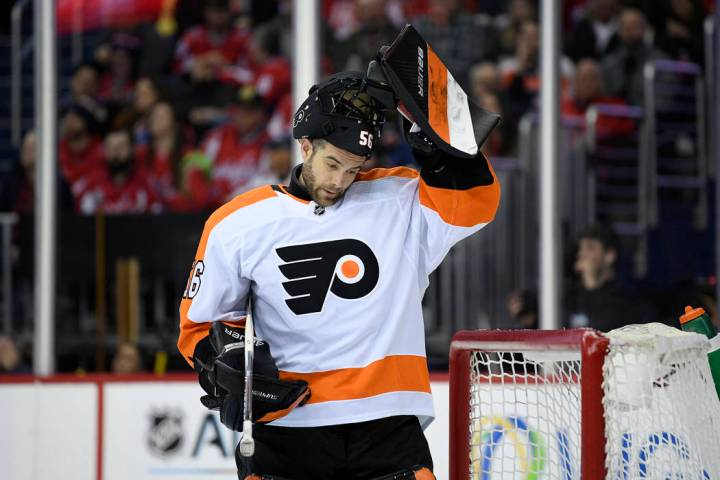 Philadelphia Flyers goaltender Mike McKenna (56) stands on the ice during the second period of ...