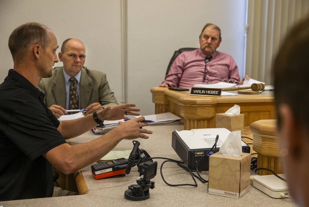 Fire Chief Eric Holt, left, as coordinator the Lincoln County Emergency Management team address ...