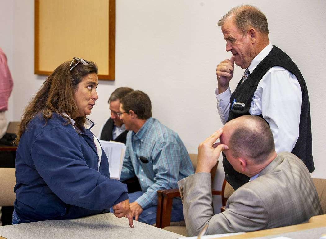 Connie West, left, of the Little A'Le'Inn in Rachel confers with District Attorney Dylan Frehne ...