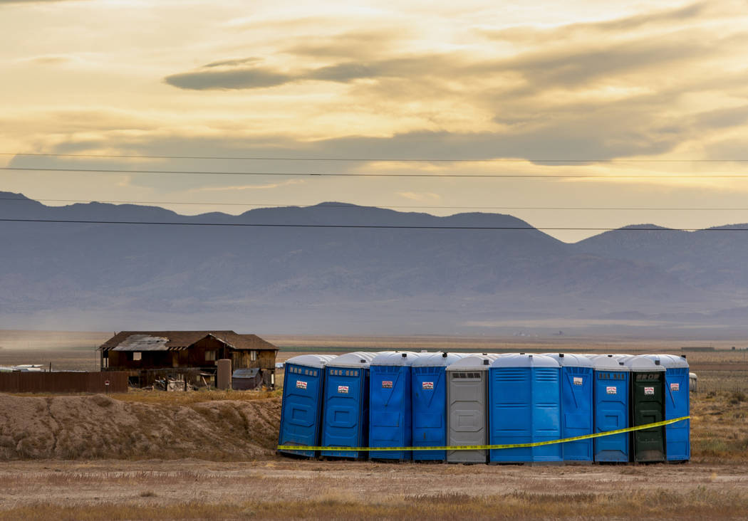 A set of port-a-potties has been set on the edge of the Alienstock festival grounds where the f ...