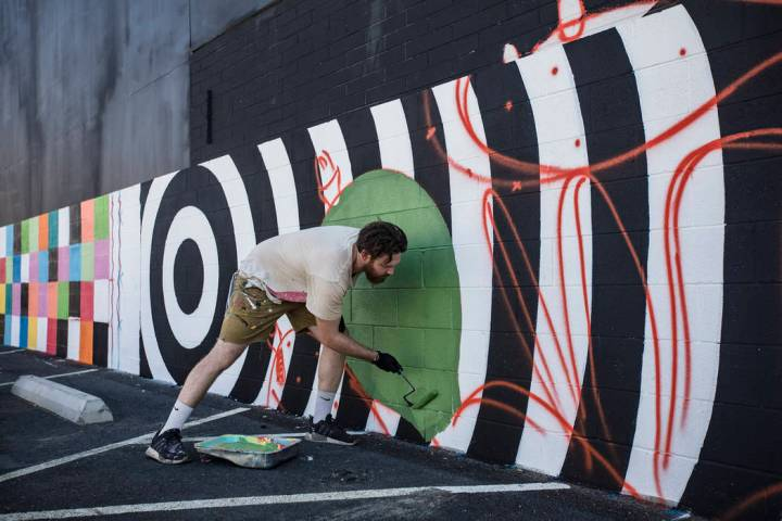 """Artist Eric Vozzola works on his mural """"An Allegory of Natural Beauty"""" for the Life i ..."""