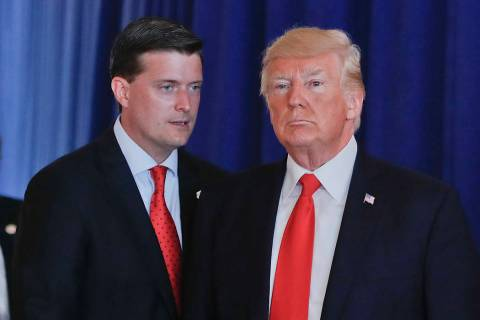 In this Aug. 12, 2017, photo, Rob Porter, left, White House Staff Secretary, speaks to Presiden ...