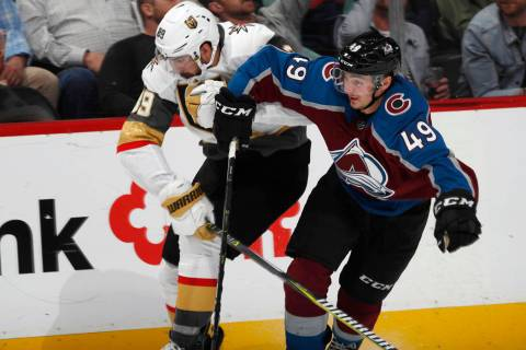 Colorado Avalanche defenseman Samuel Girard, right, fights to slow down Vegas Golden Knights ri ...