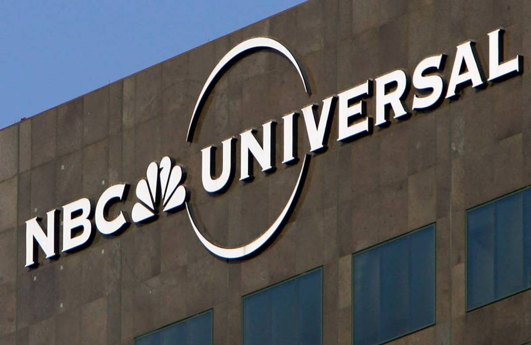 This Dec. 3, 2009, file photo, the NBC Universal logo hangs on a building in Los Angeles. Comca ...