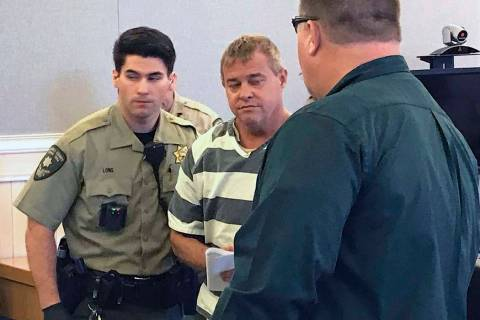 Churchill County sheriff's deputies lead John K. O'Connor from the courtroom, July 25, 2018, in ...
