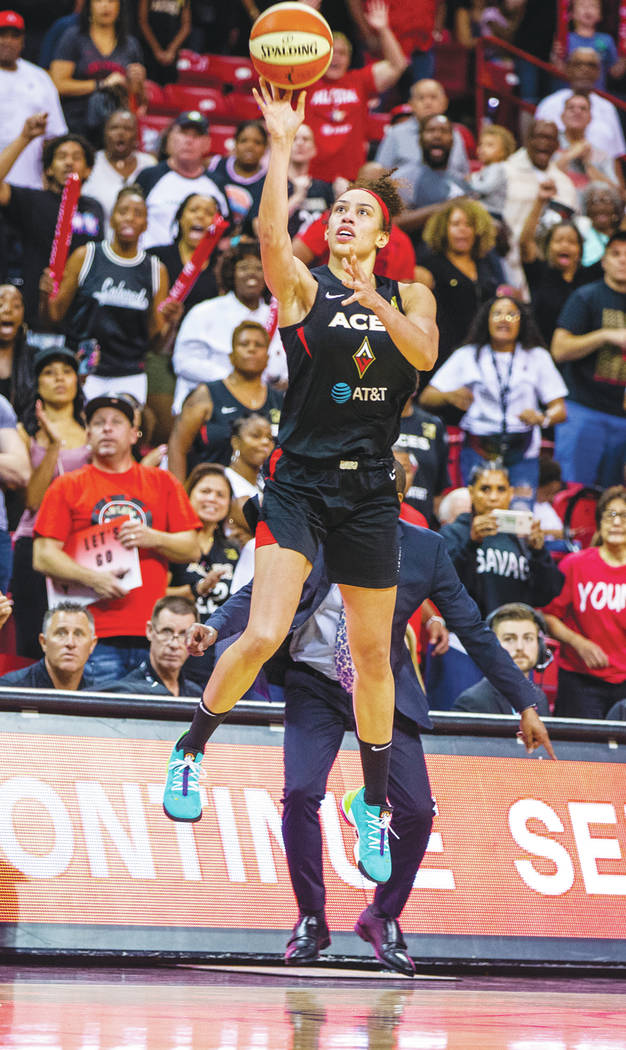 Las Vegas Aces forward Dearica Hamby (5) makes a late-game three-point-shot over the Chicago Sk ...