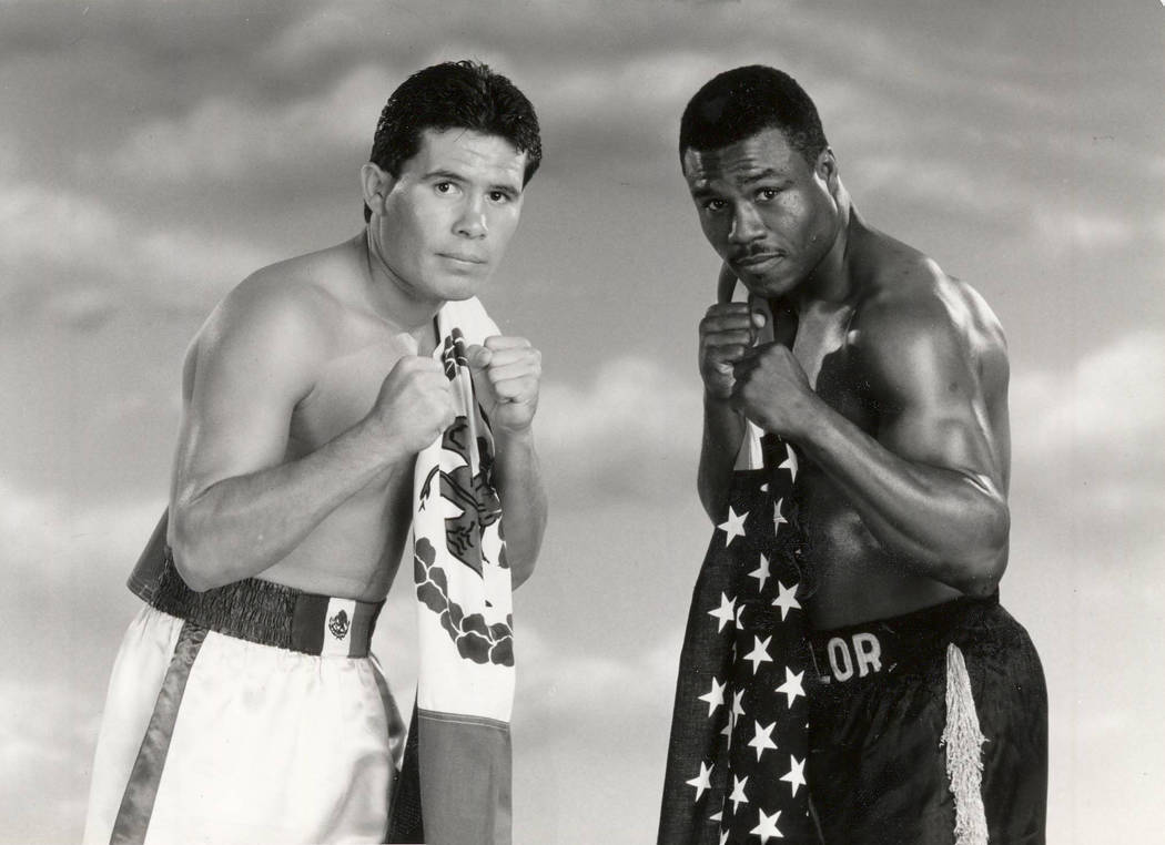 Boxer Julio Cesar Chavez, left, poses with his opponent Meldrick Taylor in this 1990 promotiona ...
