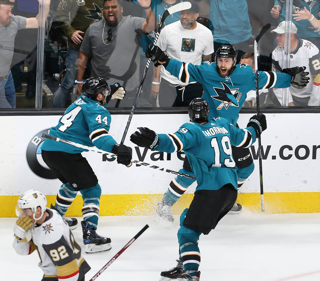 Sharks right wing Barclay Goodrow (23) celebrates with Sharks defenseman Marc-Edouard Vlasic (4 ...