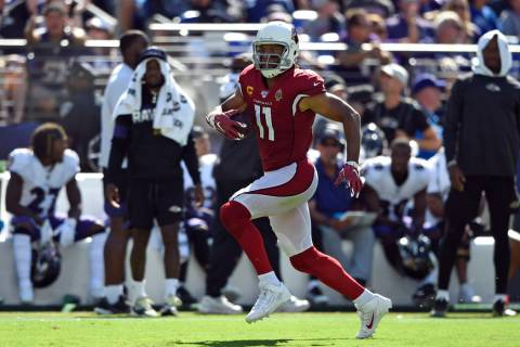Arizona Cardinals wide receiver Larry Fitzgerald rushes the ball in the second half of an NFL f ...