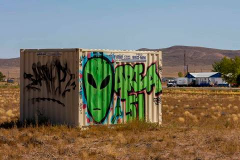 A storage container with alien and Area 51 markings sits across the street from the Little A'Le ...