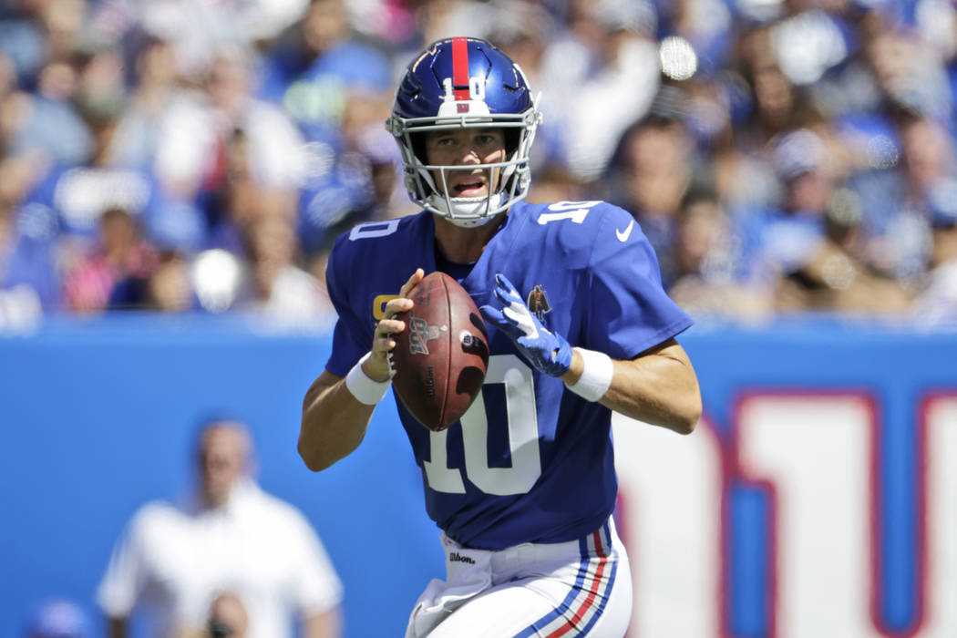 New York Giants quarterback Eli Manning looks to throw during the first half of an NFL football ...