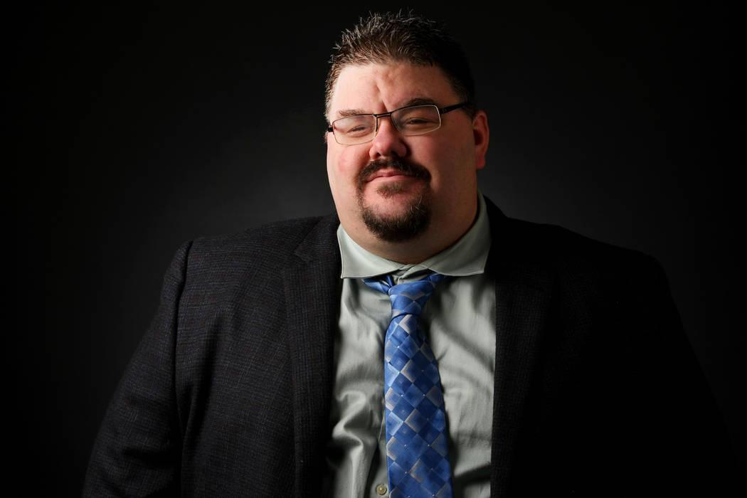 Adam Hill, reporter, poses for a portrait at the Las Vegas Review-Journal photos studio, Las Ve ...