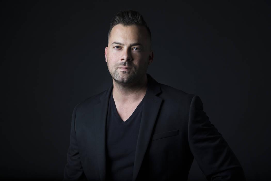 Benjamin Hager, photographer, poses for a portrait at the Las Vegas Review-Journal photos studi ...