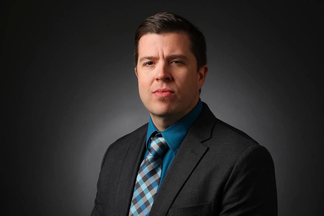 Jason Bracelin, reporter, poses for a portrait at the Las Vegas Review-Journal photos studio, L ...