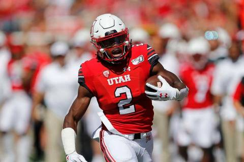 Utah running back Zack Moss (2) carries the ball in the first half of an NCAA college football ...