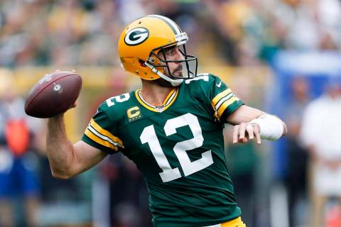 Green Bay Packers' Aaron Rodgers throws during the first half of an NFL football game against t ...