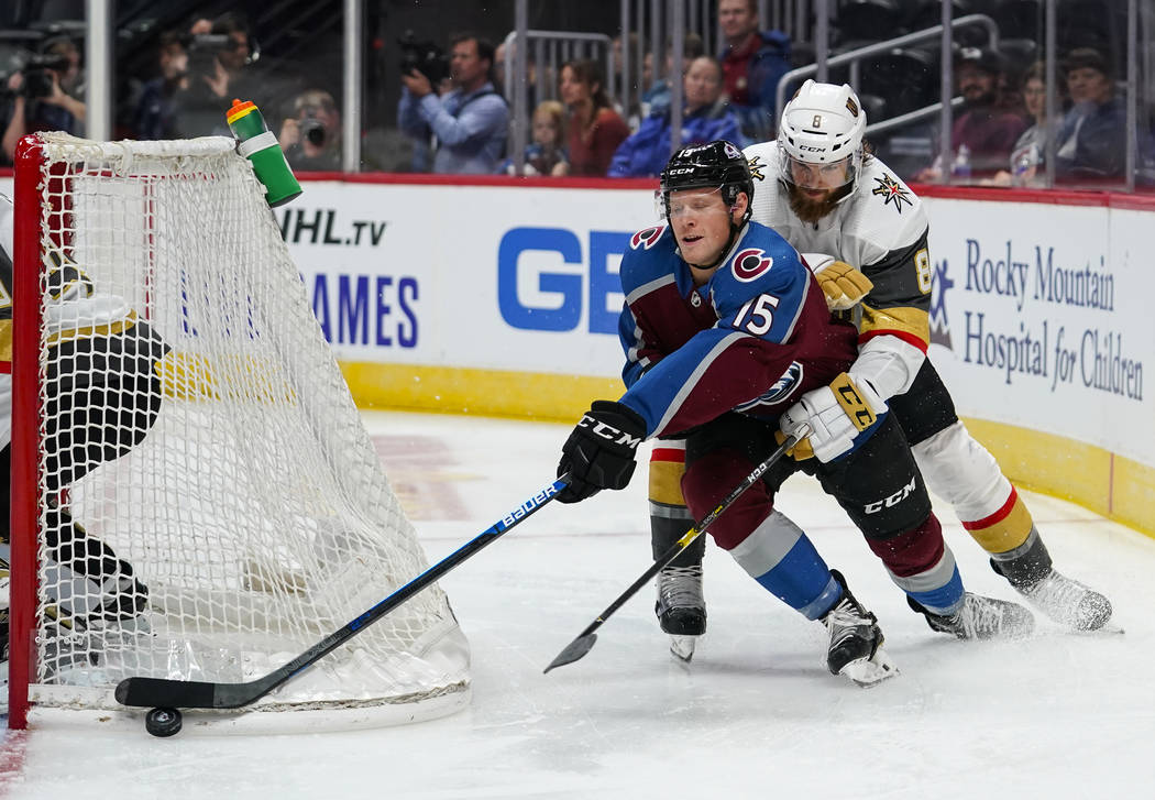 Colorado Avalanche center Sheldon Dries (15) moves the puck behind the net against Vegas Golden ...