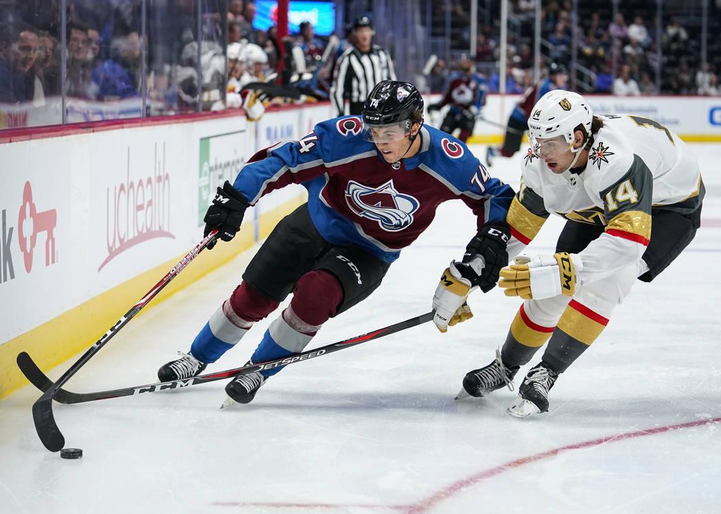 Colorado Avalanche right wing Alex Beaucage (74) skates against Vegas Golden Knights defenseman ...