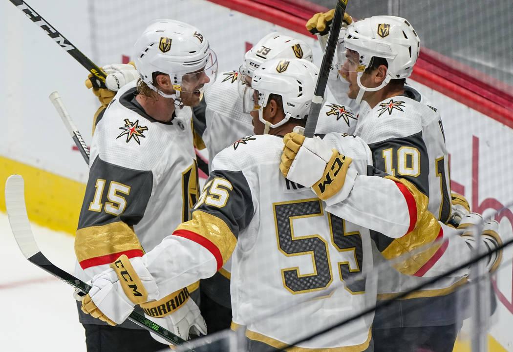 Vegas Golden Knights center Nicolas Roy (10) celebrates a goal with teammates Jon Merrill (15), ...