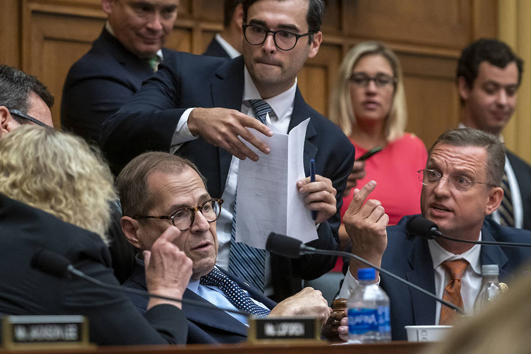 House Judiciary Committee Chairman Jerrold Nadler, D-N.Y., left, listens to Rep. Doug Collins, ...