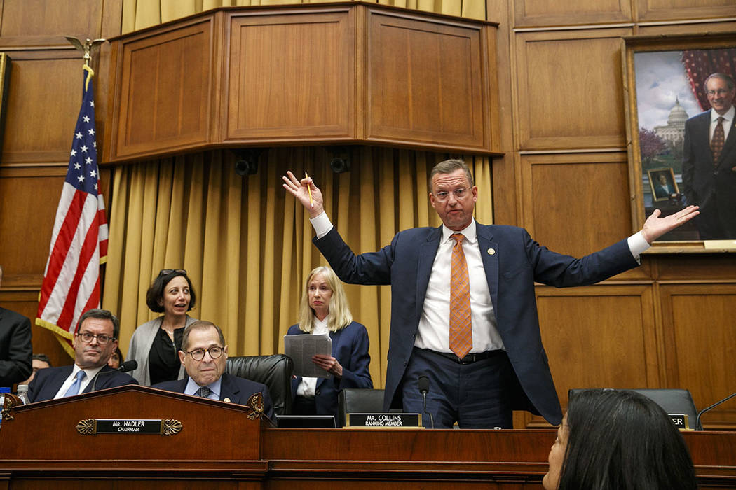 Rep. Doug Collins, R-Ga., the ranking member on the House Judiciary Committee, right, throws hi ...