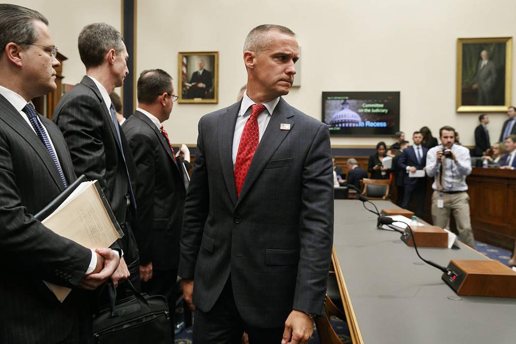 Corey Lewandowski, center, the former campaign manager for President Donald Trump, walks past W ...